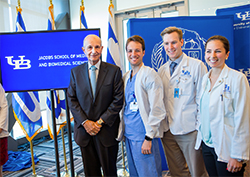 Jeremy M. Jacobs with medical students